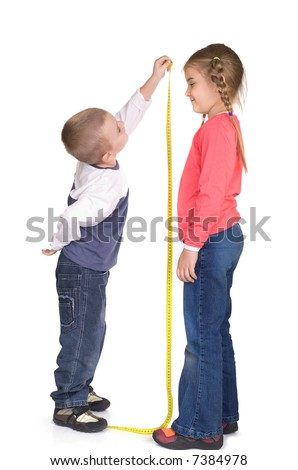 children are playing and measuring height - stock photo