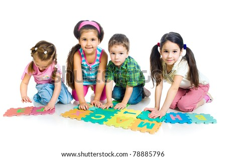 children are playing letters ; isolated on the white background - stock photo