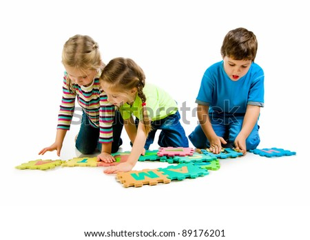 children are playing letters on the white background - stock photo