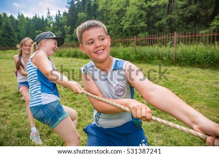 "Children are pulling the rope. Children's camp ""Berezka"".Editorial. Russia. Yaroslavl region 26.06.2016"