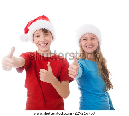 children are showing thumb up  wearing santa hats, isolated over white
