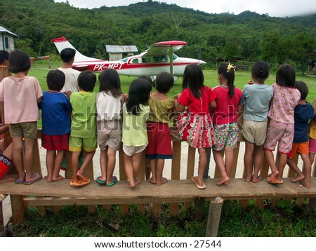 Children are watching pioneer plane type casa at borneo Indonesia.