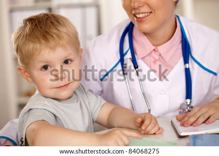 children at a reception at the doctor - stock photo