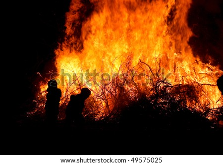 Children at major bonfire or forest fire