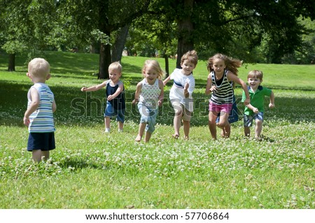 children at play on a sunny day in the park - stock photo