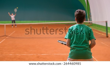 Children at school during a dribble of tennis - stock photo