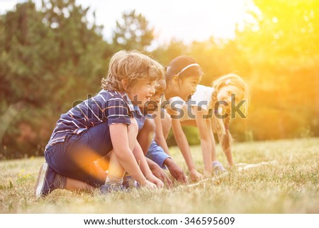 Children at the start of a race getting ready - stock photo