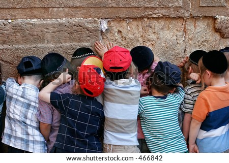 children at the wailing wall. - stock photo
