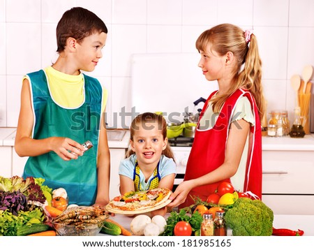 Children bake cookies at  kitchen. - stock photo