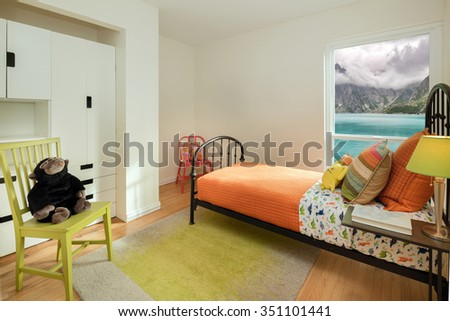 Children bedroom / kids room with colorful decoration, green rug, bed and modern chest. - stock photo