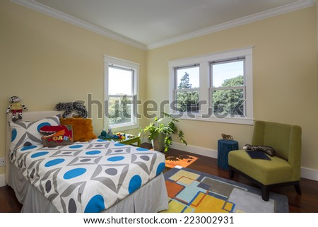 Children bedroom / kids room with olive beige walls, carpet and view window and ornamented sheet.  - stock photo