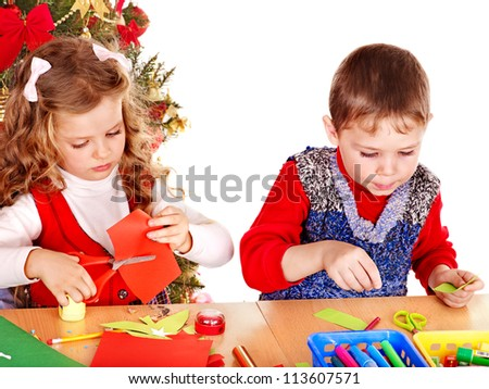 Children boy and girl making decoration card for Christmas. - stock photo