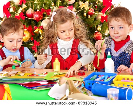 Children boy and girl making decoration for Christmas. - stock photo