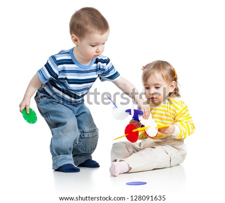 children boy and girl play with educational toy over white background
