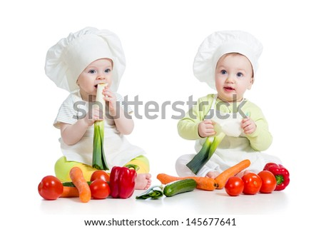 children boy and girl wearing chef hat with healthy  food vegetables - stock photo
