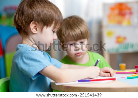children boys painting in nursery at home - stock photo