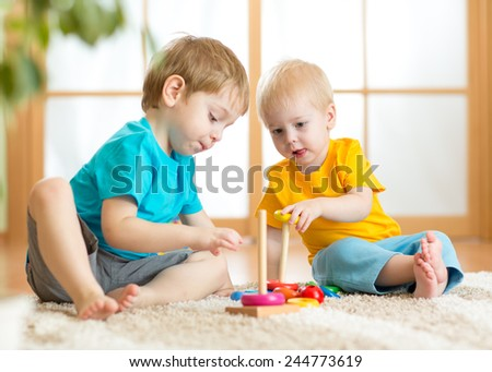 children boys with educational toys in playroom