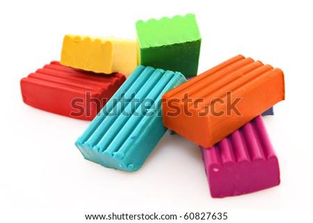 Children bright multicoloured plasticine set chaotically isolated on white - stock photo