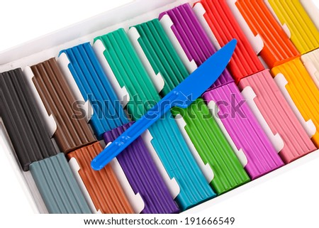 Children bright plasticine in paper box with stack isolated on white - stock photo