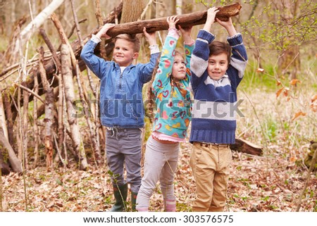 Children Building Camp In Forest Together - stock photo