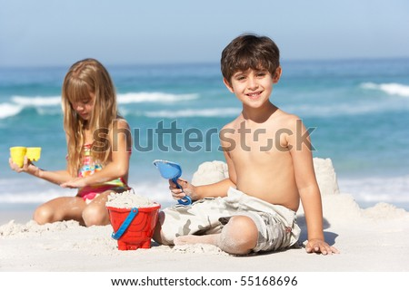 Children Building Sandcastles On Beach Holiday - stock photo
