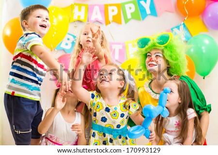 children celebrating  birthday party  merrily - stock photo