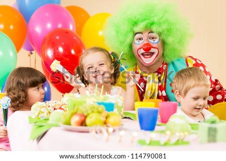 children celebrating birthday party with clown - stock photo