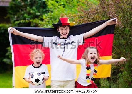 Children cheering and supporting German national football team.
