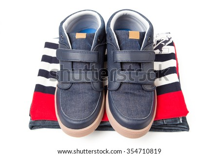 children clothes folding with shoes, isolate on white background.