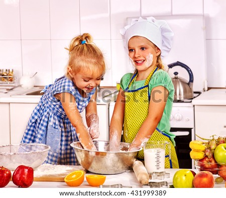 Children cooking breakfast at home kitchen. Children learning cooking.