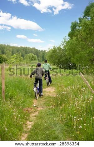 Children country biking - stock photo