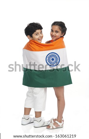 Children covering in Indian flag - stock photo
