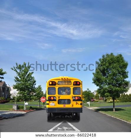 Children Crossing Traffic Sign School Bus with Happy Little Boy Inside on Suburban Residential Neighborhood Street - stock photo