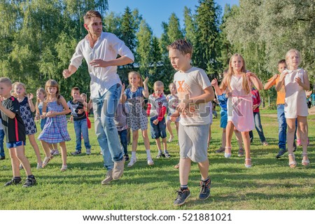 "Children dancing in field head. Children's camp ""Berezka"".Editorial. Russia. Yaroslavl region 18.08.2016"