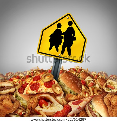 Children diet problems and obesity crisis in the school concept as a heap of unhealthy fast food with two overweight fat kids on a a crossing traffic sign as a nutrition risk symbol for the youth. - stock photo