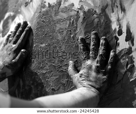 Children dirty  hands, painting game, black and white - stock photo