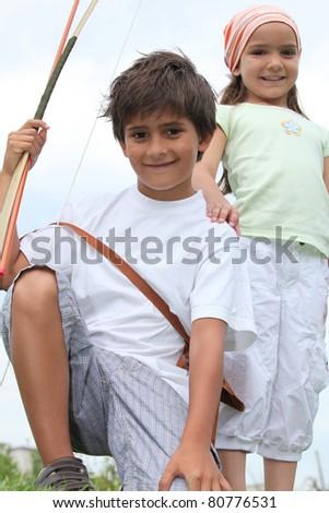 Children doing archery - stock photo