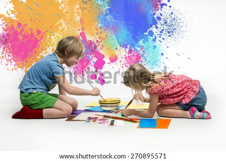 Children draw of paints on the floor - stock photo