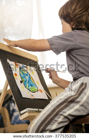 Children draw planet earth in home - stock photo