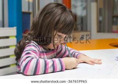 Children drawing at playroom - stock photo