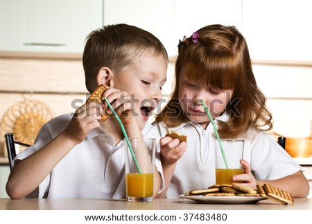 Children drink juice - stock photo