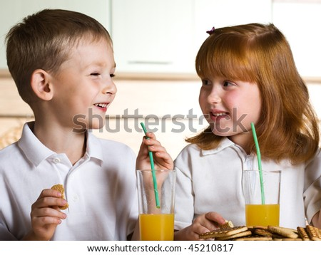 Children drink juice - stock photo
