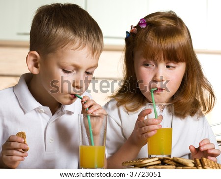 Children drinking juice - stock photo