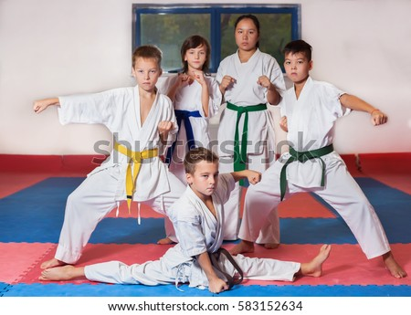children during training karate fighting position stock photo edit