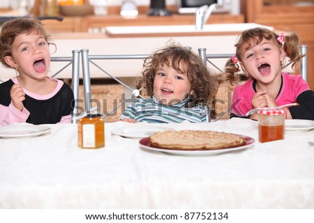 children eating a pie - stock photo