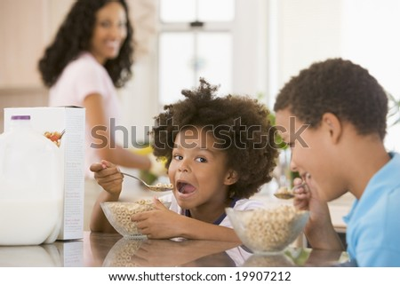 Children Eating Breakfast - stock photo