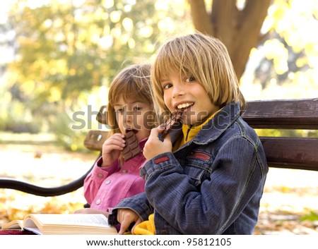children eating chocolate - stock photo