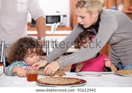 Children eating crepes - stock photo