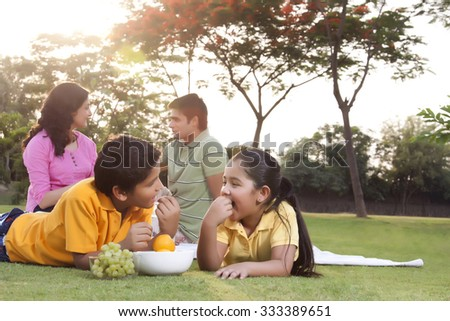 Children eating fruit - stock photo