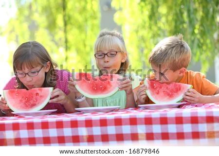 Children eating watermelon - stock photo